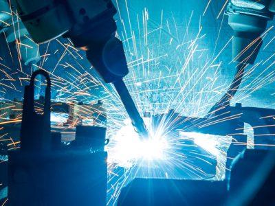 44962207 - welding robots movement in a car factory